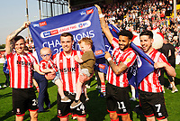 (L to r) Lincoln City's Harry Anderson, Harry Toffolo, Bruno Andrade and Tom Pett celebrate securing the League 2 Title<br /> <br /> Photographer Andrew Vaughan/CameraSport<br /> <br /> The EFL Sky Bet League Two - Lincoln City v Tranmere Rovers - Monday 22nd April 2019 - Sincil Bank - Lincoln<br /> <br /> World Copyright © 2019 CameraSport. All rights reserved. 43 Linden Ave. Countesthorpe. Leicester. England. LE8 5PG - Tel: +44 (0) 116 277 4147 - admin@camerasport.com - www.camerasport.com