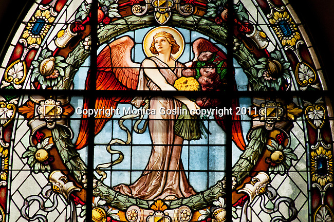 Stained glass window of an angel in the Riddarholmen Church in the old town of Stockholm, Sweden. The church was built in the late 1200's and it holds the tombs of the Swedish monarchs and aristocracy