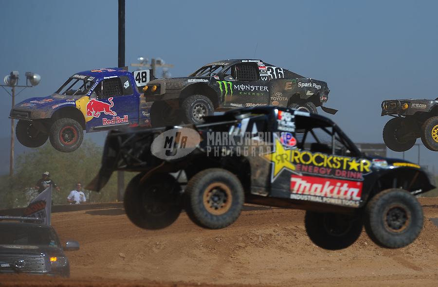 Apr 16, 2011; Surprise, AZ USA; LOORRS driver Rick Huseman (36) jumps alongside Ricky Johnson (48)during round 3 at Speedworld Off Road Park. Mandatory Credit: Mark J. Rebilas-.