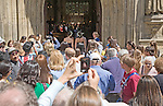 Crowds gather to glimpse and photograph a wedding taking place in Bath abbey church, Bath, Somerset, England