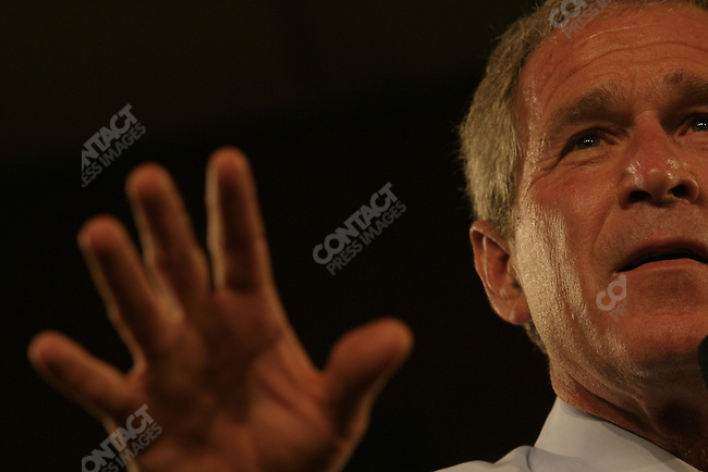 President George W Bush arrives at an 'manufacturing' event in Eau Claire WI, where he addresses local supporters, and urges them to work hard for his campaign. Eau Claire, WI, October 20, 2004.
