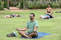 Randy Kehne of Fayetteville meditates, Saturday, June 20, 2020 at the Botanical Gardens of the Ozark in Fayetteville. Fayetteville Yoga Fest hosted a yoga class with about 60 people on the lawn of the garden to celebrate the summer solstice, the first day of summer and longest day of the year. Check out nwaonline.com/200621Daily/ for today's photo gallery. <br /> (NWA Democrat-Gazette/Charlie Kaijo)