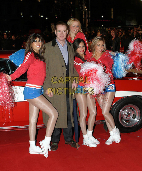 JAMES HEWITT.Starsky & Hutch UK premiere in Odeon Leicester Square.11 March 2004.dancers, girls, cheerleaders, pom-poms, full length, full-length.www.capitalpictures.com.sales@capitalpictures.com.© Capital Pictures.