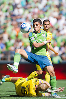 Seattle Sounders FC forward Fredy Montero (17) tries to control the ball in a match against Columbus Crew at CenturyLink Field in Seattle, Washington. Seattle Sounders FC won, 6-2.
