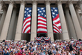 Parade-goers sit at the National Archives for the reading of the Declaration of Independence and the Independence Day Parade along Constitution Avenue in Washington DC on July 4, 2019.<br /> <br /> Credit: Stefani Reynolds / CNP