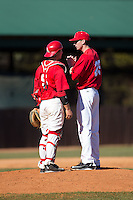 Belmont Abbey Crusaders catcher Drew Sipp (5) has a chat on the mound with starting pitcher Matt Davenport (25) during the game against the Shippensburg Raiders at Abbey Yard on February 8, 2015 in Belmont, North Carolina.  The Raiders defeated the Crusaders 14-0.  (Brian Westerholt/Four Seam Images)