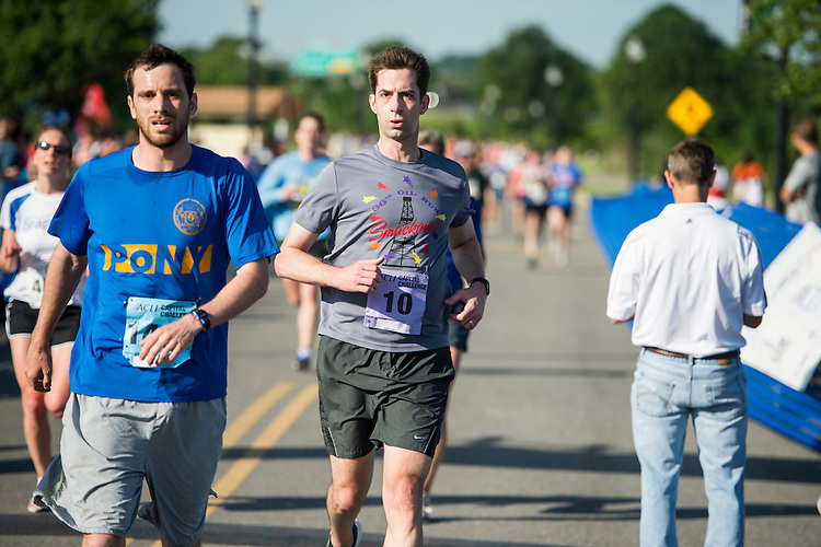UNITED STATES - MAY 20: Sen. Tom Cotton, R-Ark., crosses the finish line as the fastest Senator in the 3-mile ACLI Capital Challenge race at Anacostia Park in Washington on Wednesday, May 20, 2015. (Photo By Bill Clark/CQ Roll Call)