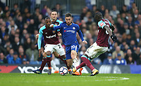 Chelsea's Eden Hazard gets in between West Ham United's Cheikhou Kouyate and Patrice Evra<br /> <br /> Photographer Rob Newell/CameraSport<br /> <br /> The Premier League - Chelsea v West Ham United - Sunday 8th April 2018 - Stamford Bridge - London<br /> <br /> World Copyright &copy; 2018 CameraSport. All rights reserved. 43 Linden Ave. Countesthorpe. Leicester. England. LE8 5PG - Tel: +44 (0) 116 277 4147 - admin@camerasport.com - www.camerasport.com