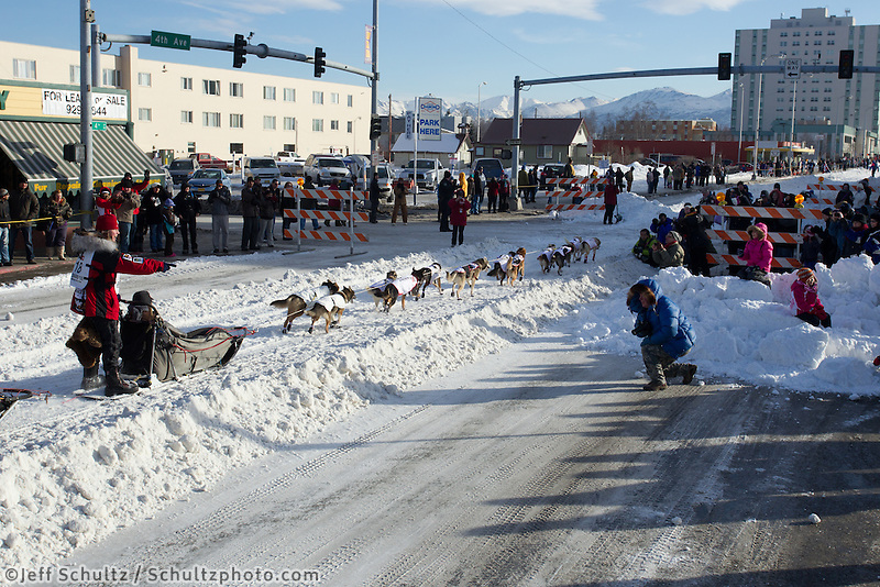 Aily Zirkle and team run down 4th avenue in downtown Anchorage, Alaska during the ceremonial start of the 2011 Iditarod