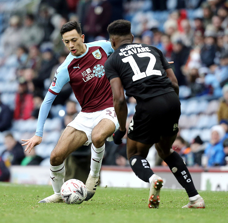 Burnley's Dwight McNeil under pressure from Dimitri Cavare<br /> <br /> Photographer Rich Linley/CameraSport<br /> <br /> Emirates FA Cup Third Round - Burnley v Barnsley - Saturday 5th January 2019 - Turf Moor - Burnley<br />  <br /> World Copyright © 2019 CameraSport. All rights reserved. 43 Linden Ave. Countesthorpe. Leicester. England. LE8 5PG - Tel: +44 (0) 116 277 4147 - admin@camerasport.com - www.camerasport.com