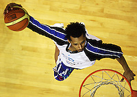 Saints import Mike Efevberha goes up for a slamdunk during the warm-up during the National Basketball League match Wellington Saints and Harbour Heat at TSB Bank Arena, Wellington, New Zealand on Saturday 13 June 2009. Photo: Dave Lintott / lintottphoto.co.nz