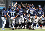 Centennial's Josh McKibin is greeted by teammates after he scored against Liberty in the NIAA Division I state baseball championship game, in Reno, Nev., on Saturday, May 24, 2014. Liberty won 5-3. (Las Vegas Review-Journal, Cathleen Allison)