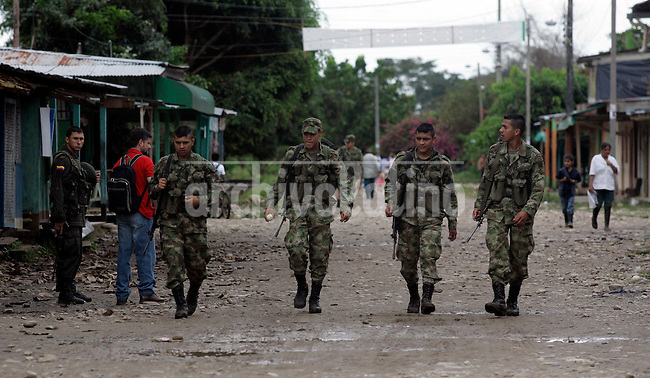 Colombia's soldiers patrol streets of La Julia, in the south of the country, in operations against leftist guerrilla FARC