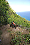 Hawaii: Molokai, the Mule Ride from the cliff tops down 1,600 feet to the leper colony at Kalaupapa. Model released..Photo himolo147-72218.Photo copyright Lee Foster, www.fostertravel.com, lee@fostertravel.com, 510-549-2202