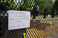 Signs are hung on additional fencing near the White House in Washington D.C., U.S., on Wednesday, June 10, 2020.  Additional fencing that has been set up near the White House due to protests over the death of George Floyd are expected to be taken down shortly.  Credit: Stefani Reynolds / CNP/AdMedia