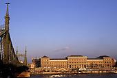 Budapest, Hungary. University of Economics and the Gellert Bridge.