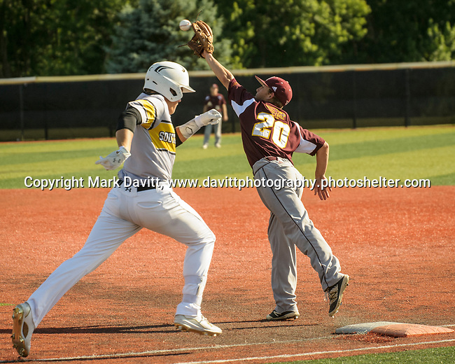 Southeast Polk and Ankeny met for a double header at SEP June 21. SEP prevailed twice, 2-0 and 8-1. AHS's Seth Harpenau gets pulled off first base allowing SEP's Adam Schneider to safely reach the bag.