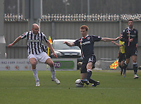 Scott Boyd gets to the ball before Sam Parkin in the St Mirren v Ross County Clydesdale Bank Scottish Premier League match played at St Mirren Park, Paisley on 19.1.13.