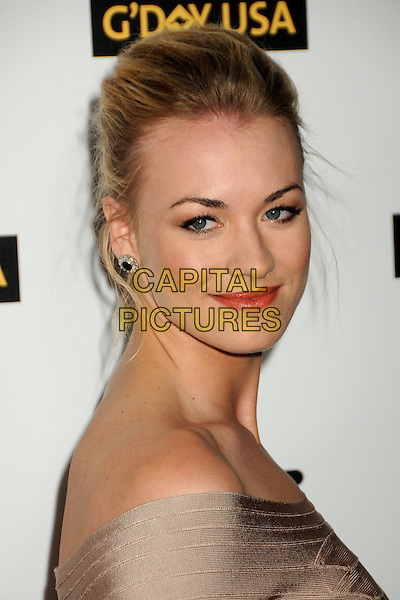 YVONNE STRAHOVSKI.Attending the 2010 G'Day USA Australia Week Black Tie Gala held at the Hollywood & Highland Grand Ballroom, Hollywood, California, USA, .16th January 2010..arrivals portrait headshot hair up earrings side beige .CAP/ADM/BP.©Byron Purvis/Admedia/Capital Pictures