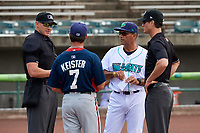 Lynchburg Hillcats manager Rouglas Odor (24) and Potomac Nationals manager Tripp Keister (7) meet with home plate umpire Mike Snover and umpire Mark Bass for the lineup exchange before the first game of a doubleheader against the Potomac Nationals on June 9, 2018 at Calvin Falwell Field in Lynchburg, Virginia.  Lynchburg defeated Potomac 5-3.  (Mike Janes/Four Seam Images)