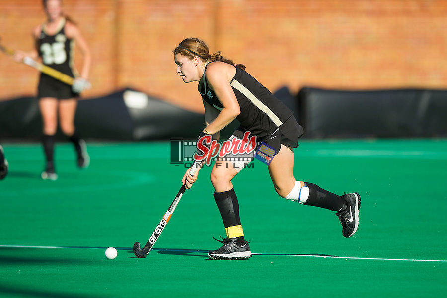 Christine Conroe (4) of the Wake Forest Demon Deacons pushes the ball up the field during second half action against the Liberty Flames at Kentner Stadium on September 13, 2013 in Winston-Salem, North Carolina.  The Demon Deacons defeated the Flames 3-2.  (Brian Westerholt/Sports On Film)