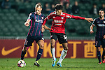 SC Kitchee Defender Krisztin Vadocz (c) in action against Muangthong United Midfielder Wattana Playnum (r) during the 2017 Lunar New Year Cup match between SC Kitchee (HKG) vs Muangthong United (THA) on January 28, 2017 in Hong Kong, Hong Kong. Photo by Marcio Rodrigo Machado/Power Sport Images
