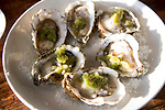 Half a dozen oysters in shells with granita dressing