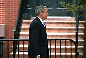 Just a walk in the park -- United States President George W. Bush walks by Lafayette Park in front of the White House in Washington, DC to a Republican Governors Association reception at Decatur House on October 22, 2007. <br /> Credit: Dennis Brack / Pool via CNP