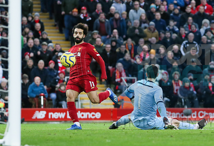 Mohamed Salah of Liverpool scores the third goal of the game during the Premier League match at Anfield, Liverpool. Picture date: 1st February 2020. Picture credit should read: James Wilson/Sportimage