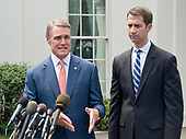 United States Senator David Perdue (Republican of Georgia), left, and US Senator Tom Cotton (Republican of Arkansas), right, speak to reporters outside the White House after meeting US President Donald J. Trump to discuss their proposed legislation to enact a skills-based immigration system called the Reforming American Immigration for a Strong Economy (RAISE) Act that they claim would also result in a lower level of immigration.<br /> Credit: Ron Sachs / CNP