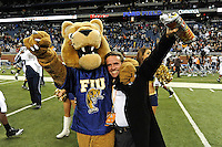 26 December 2010:  FIU's mascot, Roary, celebrates with FIU Associated Athletic Director Jose Sotolongo after the FIU Golden Panthers defeated the University of Toledo Rockets, 34-32, to win the 2010 Little Caesars Pizza Bowl at Ford Field in Detroit, Michigan.