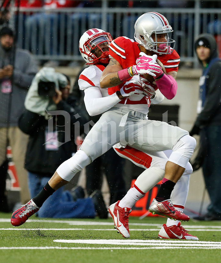 Ohio State Buckeyes wide receiver Devin Smith (9) catches a pass while bend defended by Rutgers Scarlet Knights defensive back Delon Stephenson (27) during the third quarter of the NCAA football game at Ohio Stadium in Columbus on Oct. 18, 2014. (Adam Cairns / The Columbus Dispatch)