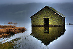 An old flooded boat house on Lake Windermere, Lake District, England