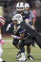Cedar Ridge quarterback Daryl Lydon hands off to Ronald Dogan Friday against Rouse at Dragon Stadiu,.  (LOURDES M SHOAF for Round Rock Leader.)