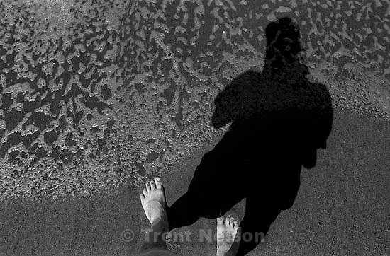 Trent feet and shadow and waves at beach<br />