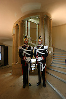 Due Corazzieri aspettano di entrare in sala stampa durante le consultazioni per eleggere un nuovo governo.<br /> Two Cuirassiers waiting for the Political talks at the Quirinal Palace in Rome, <br /> The Cuirassiers' Regiment are an Italian elite military unit and the honor guard of the President of the Italian Republic.
