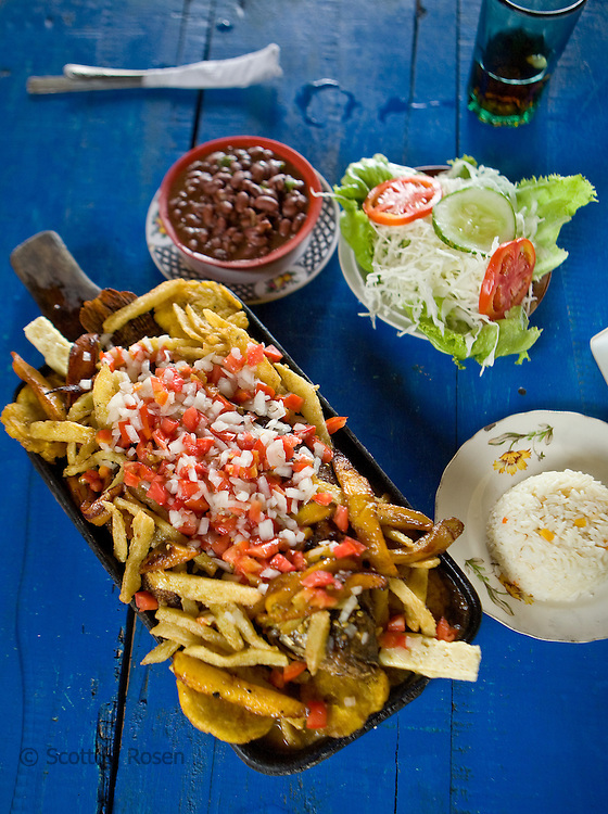 Fresh fish with french fries, beans, and salad, Laguna de Apoyo, Granada, Nicaragua