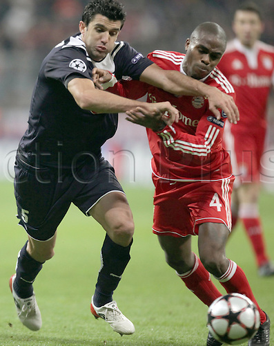 Bayern Munich's Dutch Edson Braafheid (R) fights for the ball with Bordeaux's Fernando during the Champions League group stage match between German Bundesliga club FC Bayern Munich and French side Girondins Bordeaux at Allianz Arena stadium in Munich, Germany, 03 November 2009. Bordeaux defeated Bayern Munich 2-0. Photo by Lukas Barth/actionplus UK Licenses Only