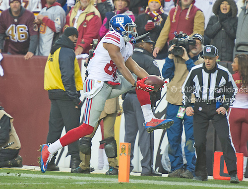 New York Giants wide receiver Rueben Randle (82) catches an Eli Manning pass for a touchdown in the fourth quarter against the Washington Redskins at FedEx Field in Landover, Maryland on Sunday, November 29, 2015.  The Redskins won the game 20-14.<br /> Credit: Ron Sachs / CNP<br /> (RESTRICTION: NO New York or New Jersey Newspapers or newspapers within a 75 mile radius of New York City)