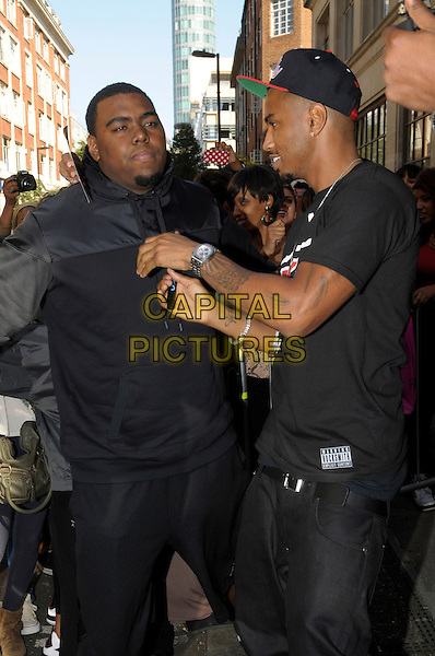 Trey Songz (Tremaine Aldon Neverson).leaving BBC Radio 1, London, England..5th September 2012.half length black t-shirt baseball cap hat side profile tattoos minder security bodyguard.CAP/IA.©Ian Allis/Capital Pictures.