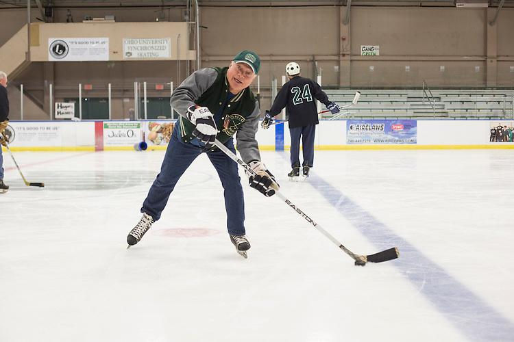 Tom Gosiorowski skates with other 1960s hockey alumni at Bird Arena on October 1, 2016.