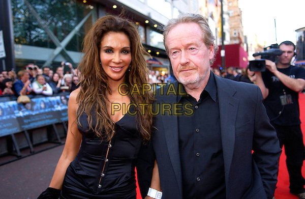"GIANINNA FACIO & RIDLEY SCOTT.European Film Premiere of ""Kingdom of Heaven"",.Empire Cinema, Leicester Square, London, .May 2nd 2005..half length.Ref: DH.www.capitalpictures.com.sales@capitalpictures.com.©Capital Pictures."