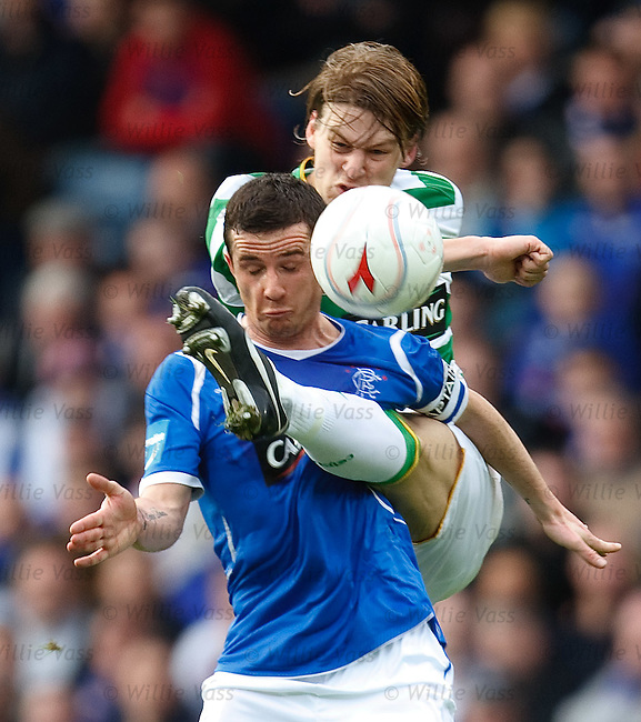 Barry ferguson feels the force of a Glen Loovens high challenge