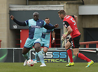 Adebayo Akinfenwa (L) of Wycombe Wanderers challenge for the ball against Ryan Edwards (R) of Morecambe during the Sky Bet League 2 match between Morecambe and Wycombe Wanderers at the Globe Arena, Morecambe, England on 29 April 2017. Photo by Stephen Gaunt / PRiME Media Images.