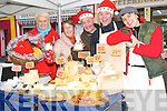 Say cheese: Traders at the Listowel Farmer's Market where a host of local produce will tickle your taste buds each Friday during the Christmas season. Pictured are Olga Demery, (home baking), Ruth O'Quigley, (vegetarian foods), Colin Summers (cakes and pastries) and Ireneusz and Anna Zaj, with their delicious selection of cheese.   Copyright Kerry's Eye 2008