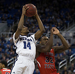 Nevada guard Lindsey Drew (14) shoots over Fresno State forward Nate Grimes (32) during the first half of a basketball game played at Lawlor Events Center in Reno, Nev., Saturday, Feb. 22, 2020.