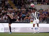 Calcio, finale Tim Cup: Milan vs Juventus. Roma, stadio Olimpico, 21 maggio 2016.<br /> Juventus&rsquo; Juan Cuadrado, left, is challenged by AC Milan&rsquo;s Mattia De Sciglio during the Italian Cup final football match between AC Milan and Juventus at Rome's Olympic stadium, 21 May 2016.<br /> UPDATE IMAGES PRESS/Isabella Bonotto