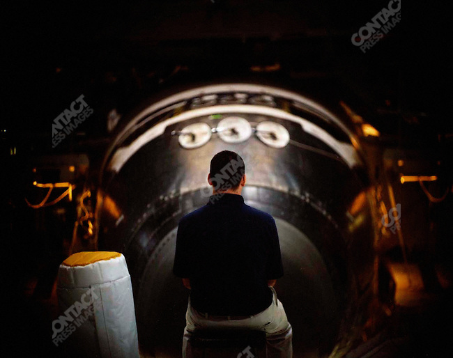 The end of the Space Shuttle program. John Cox a Space Shuttle inspector with the Shuttle Atlantis behind him in the Orbiter Processing Facility. Kennedy Space Center, Cape Canaveral, Florida, April 29, 2010