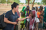 Heydi Foster, the CEO of Misean Cara, greets girls in the Doro Refugee Camp in Maban, South Sudan. The camp is one of four in Maban that together shelter more than 130,000 refugees from the Blue Nile region of Sudan. <br /> <br /> Misean Cara supports the work of Jesuit Refugee Service in the Maban camps.