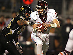 18 November 2006: Virginia Tech's Sean Glennon (7) slips away from Wake Forest's Jyles Tucker (behind). The Virginia Tech Hokies defeated the Wake Forest University Demon Deacons 27-6 at Groves Stadium in Winston-Salem, North Carolina in an Atlantic Coast Conference NCAA Division I College Football game.